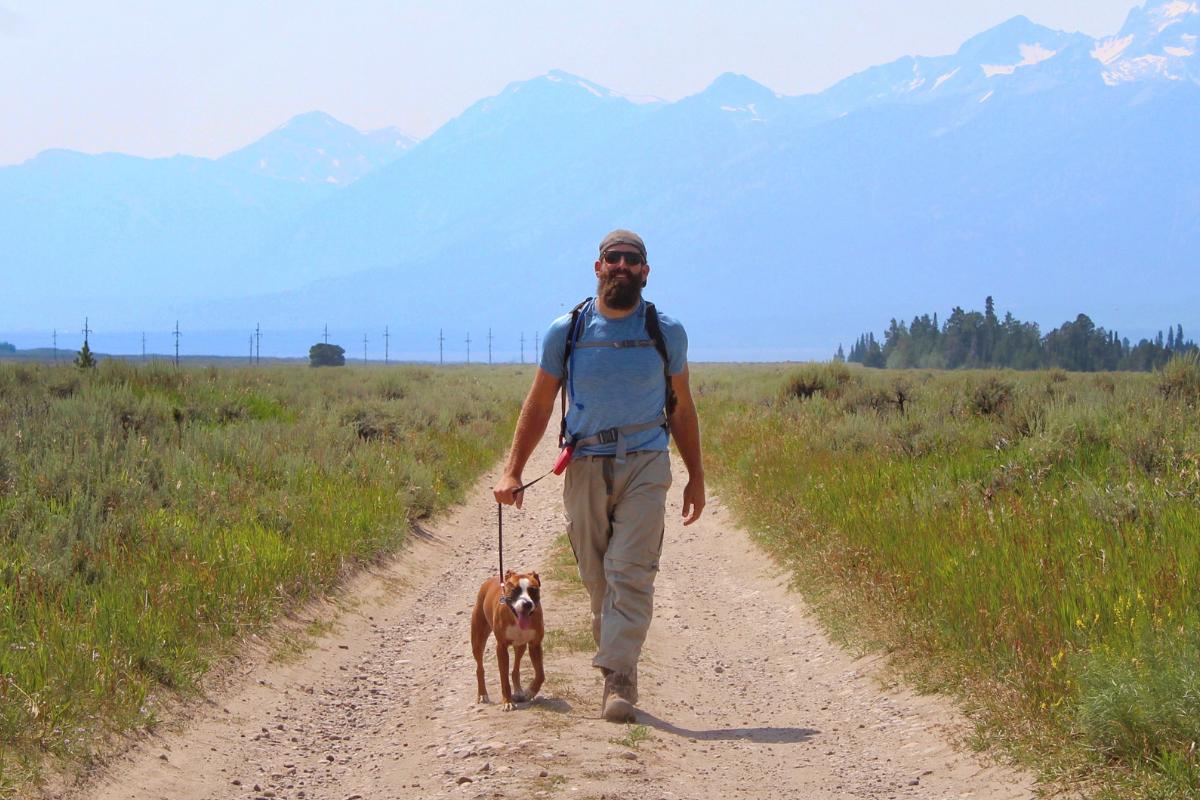 happy man dog practicing walking habit