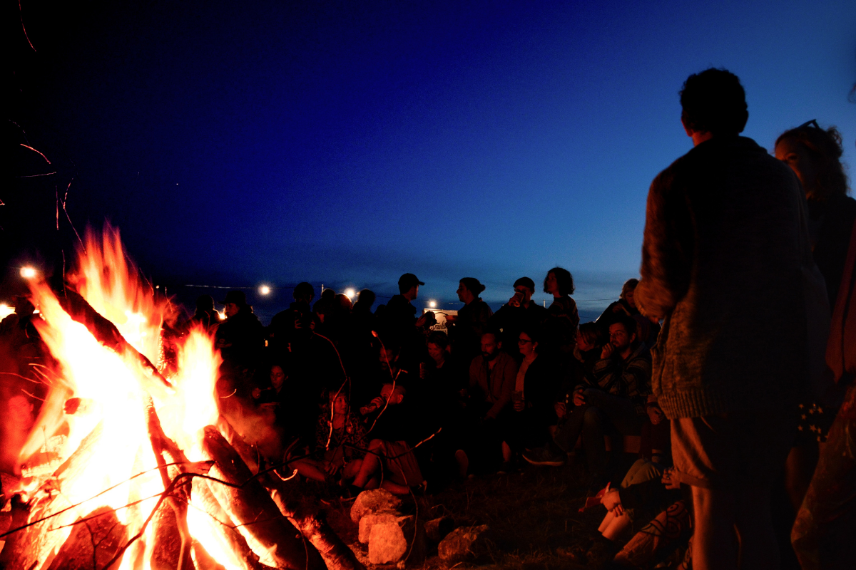group camp fire after rafting adventure