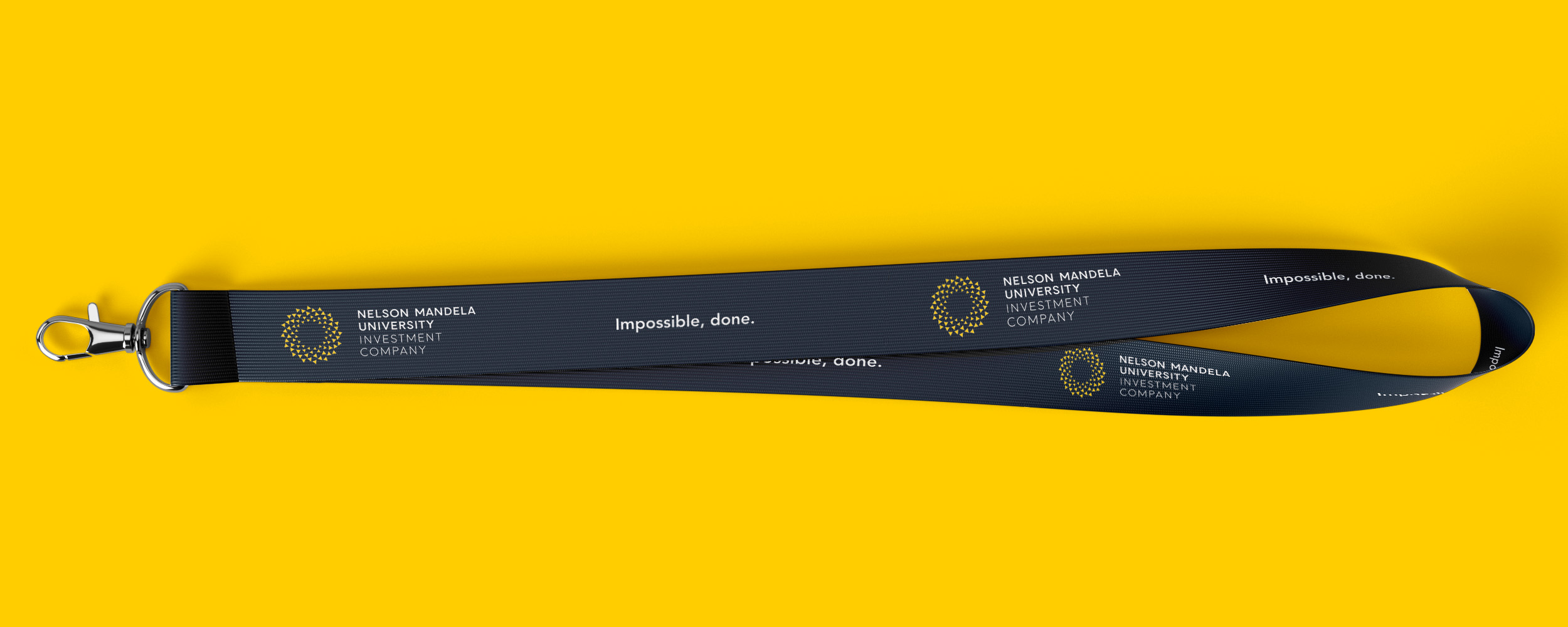 Creative Caterpillar client Nelson Mandela University Investment Company lanyard.