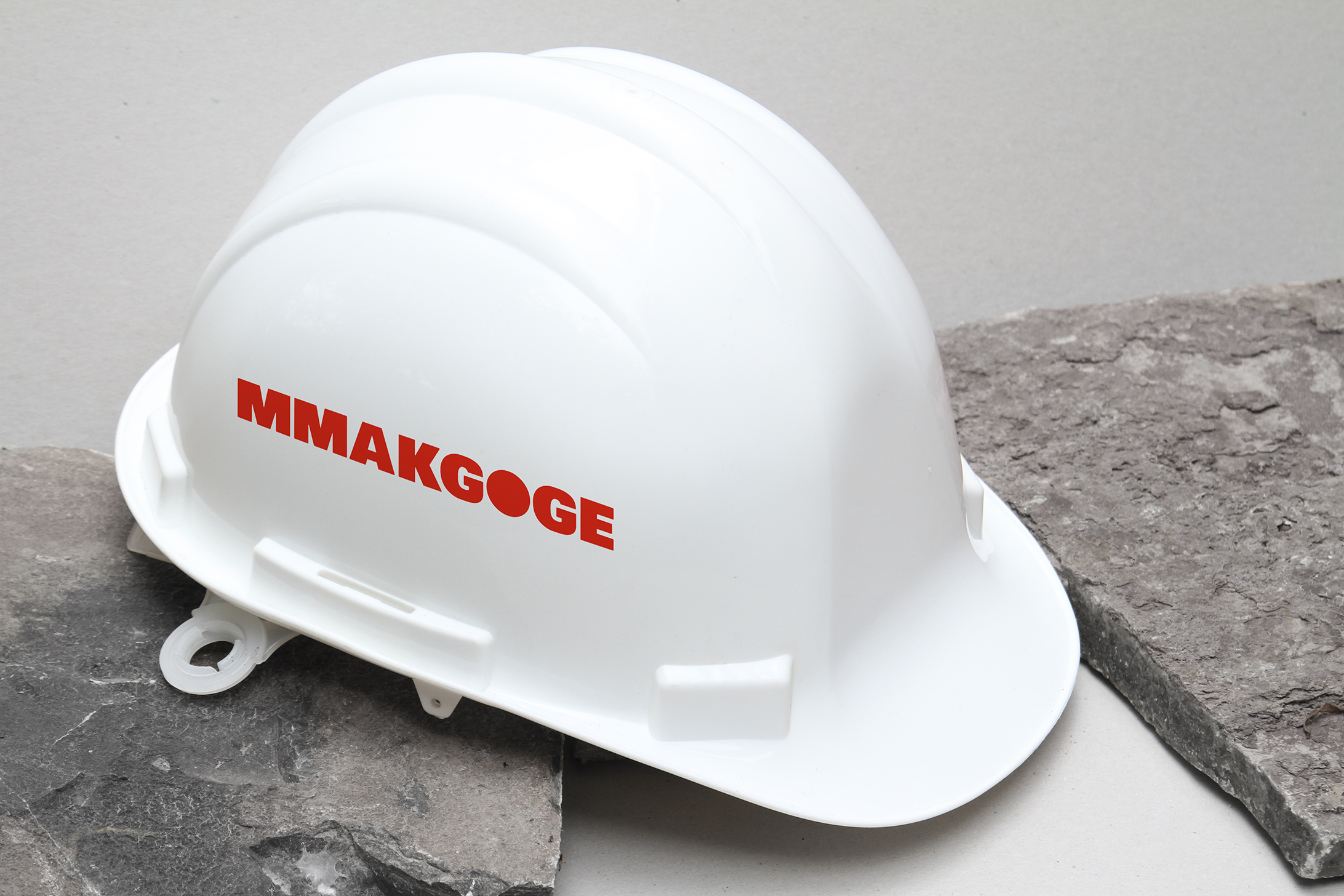 Creative Caterpillar client Mmakgoge Group  hard hat logo application.