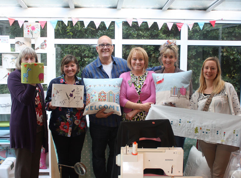 Group showing their cushions and lampshades made at the workshop