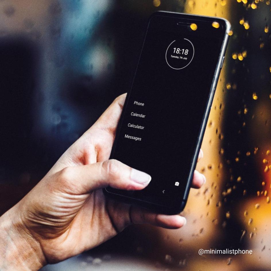 minimalist phone with dark theme installed on an Android smartphone