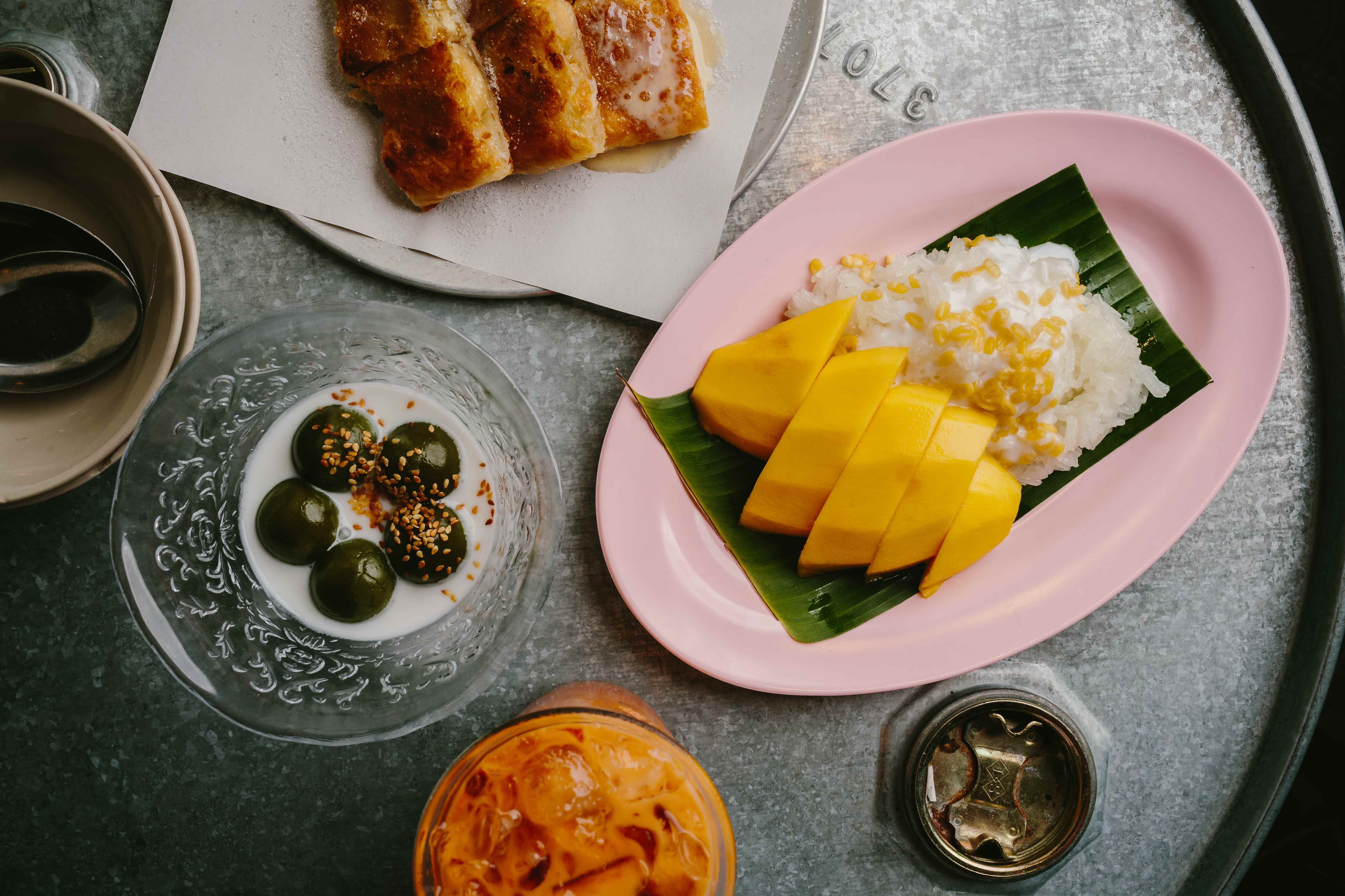 Thai mango sticky rice, pandan & coconut dumplings. Come for the food, stay for our desserts!