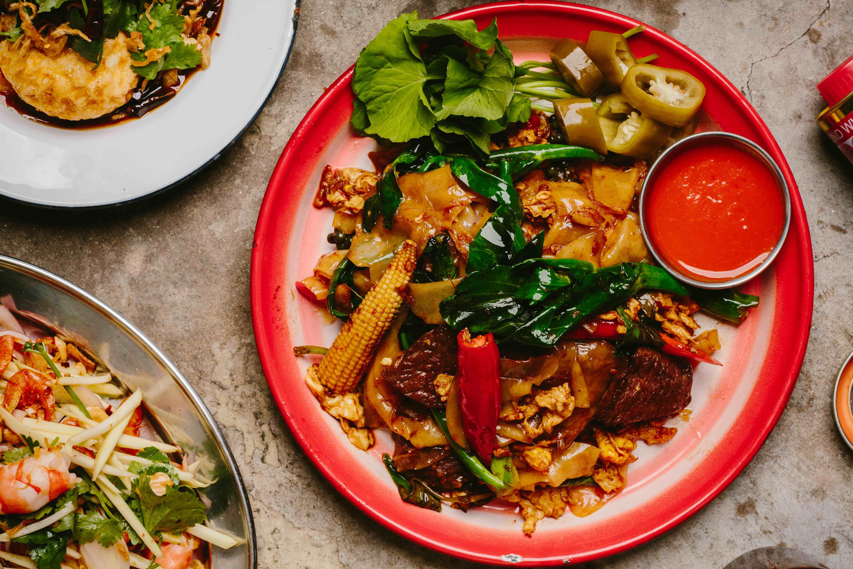 stir fried flat noodles w/ wagyu beef, green peppercorns, chili & Thai basil