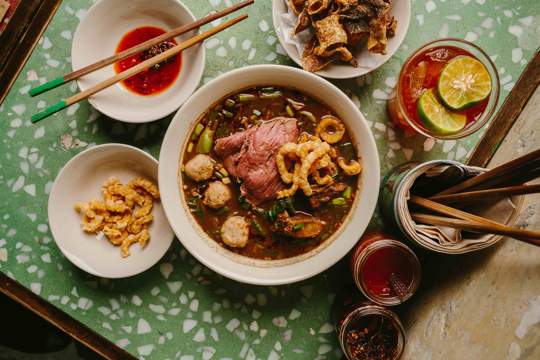 Samsen wagyu beef noodle soup w/ thin rice noodles, crispy pork rinds & Thai watercress
