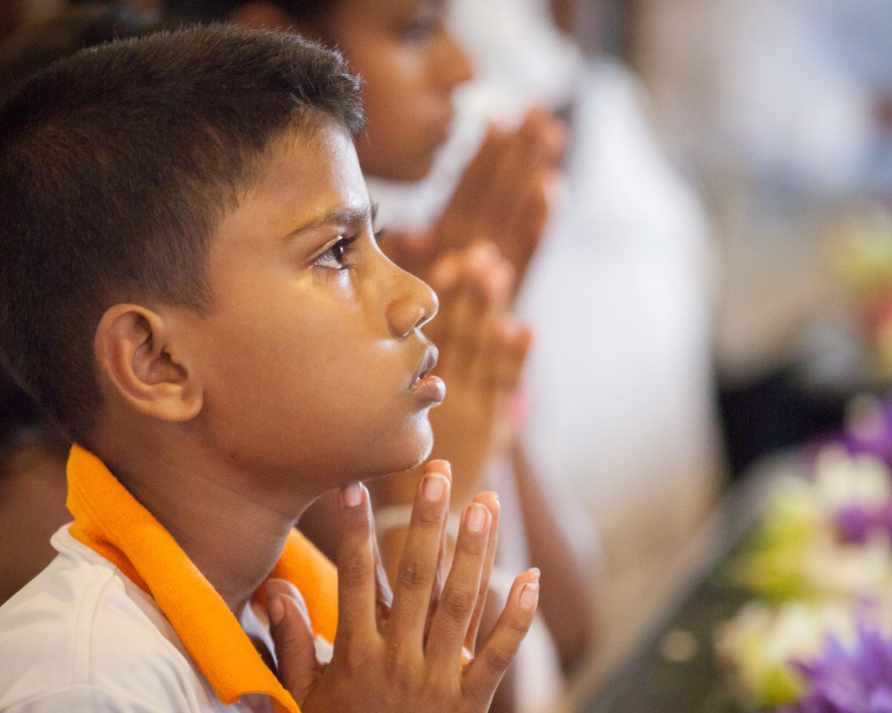 Indian child praying