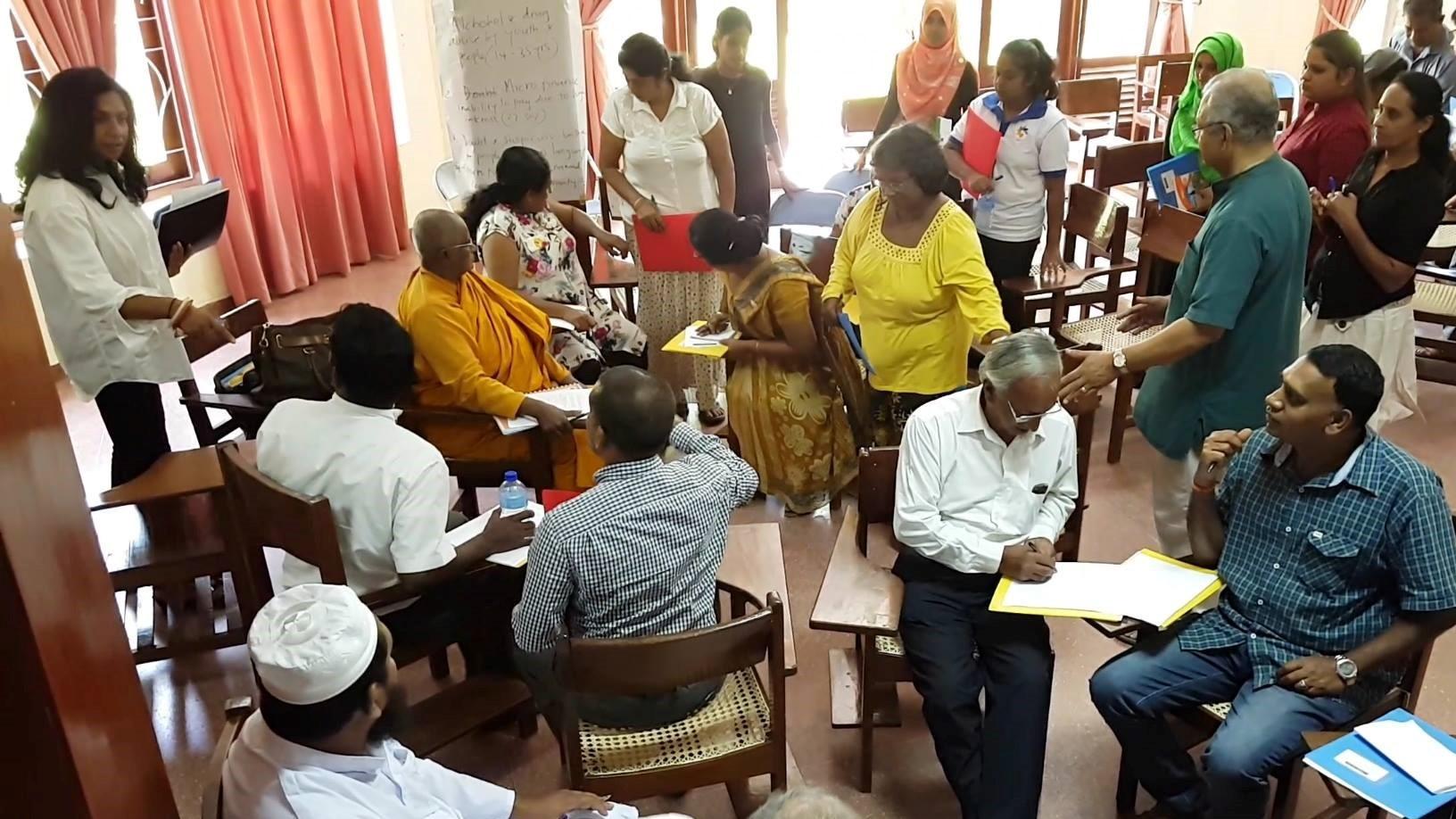 A Peacemaker Team in Sri Lanka sitting at desks working together