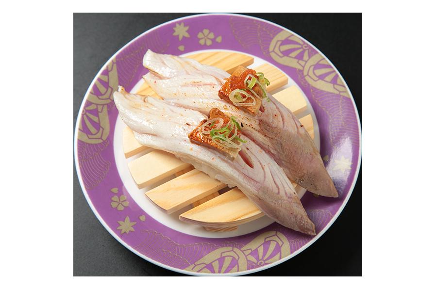 Delicious hamachi belly nigiri on a purple plate