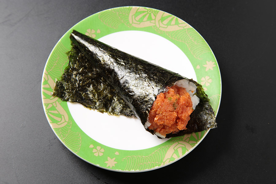 Spicy tuna and cucumber hand roll.
