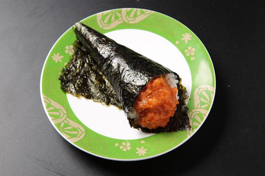 Spicy salmon and cucumber hand roll.