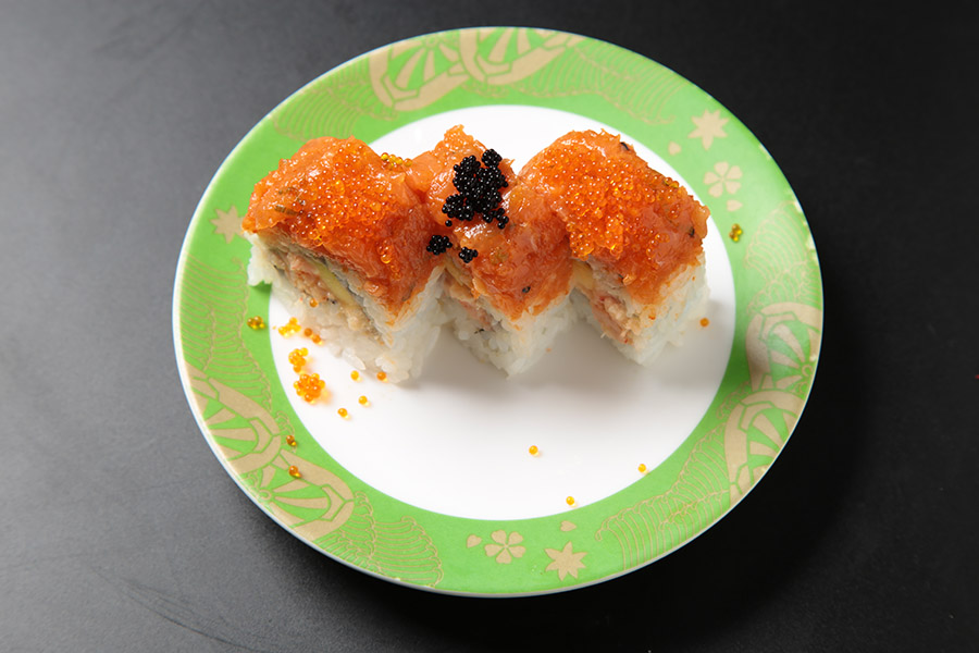 9 pcs lobster salad mango roll topped with spicy salmon & black tobiko