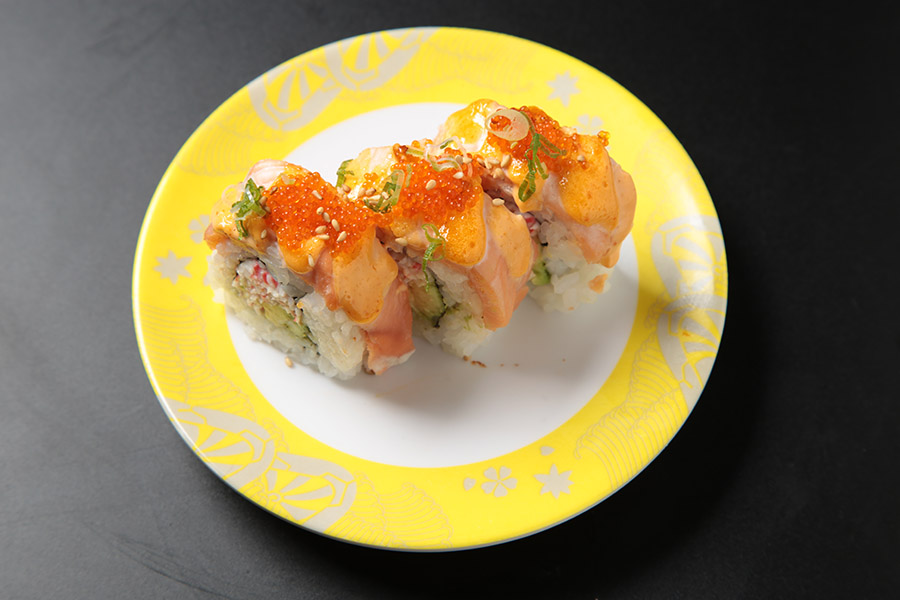 9 pcs avocado roll w/ imitation crab topped w/ salmon & our special sauce