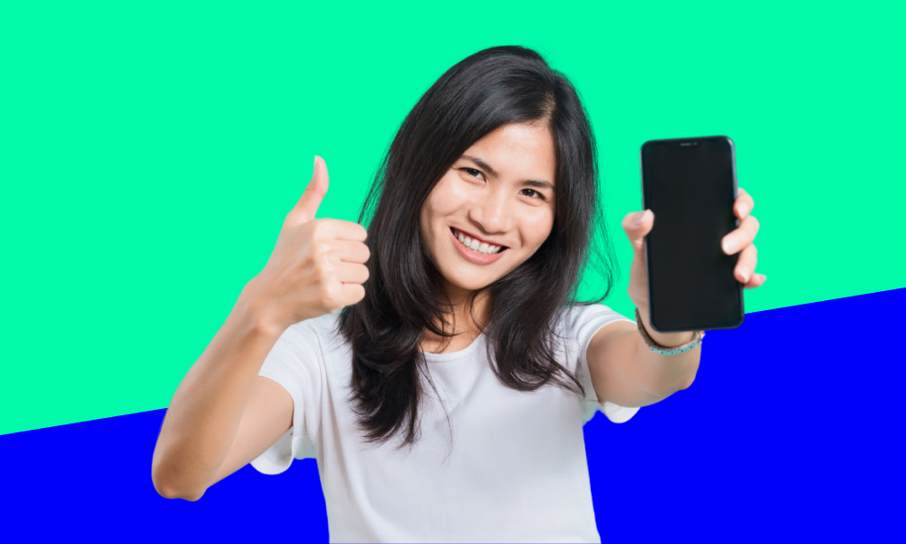 Girl thumbs up and holding a phone