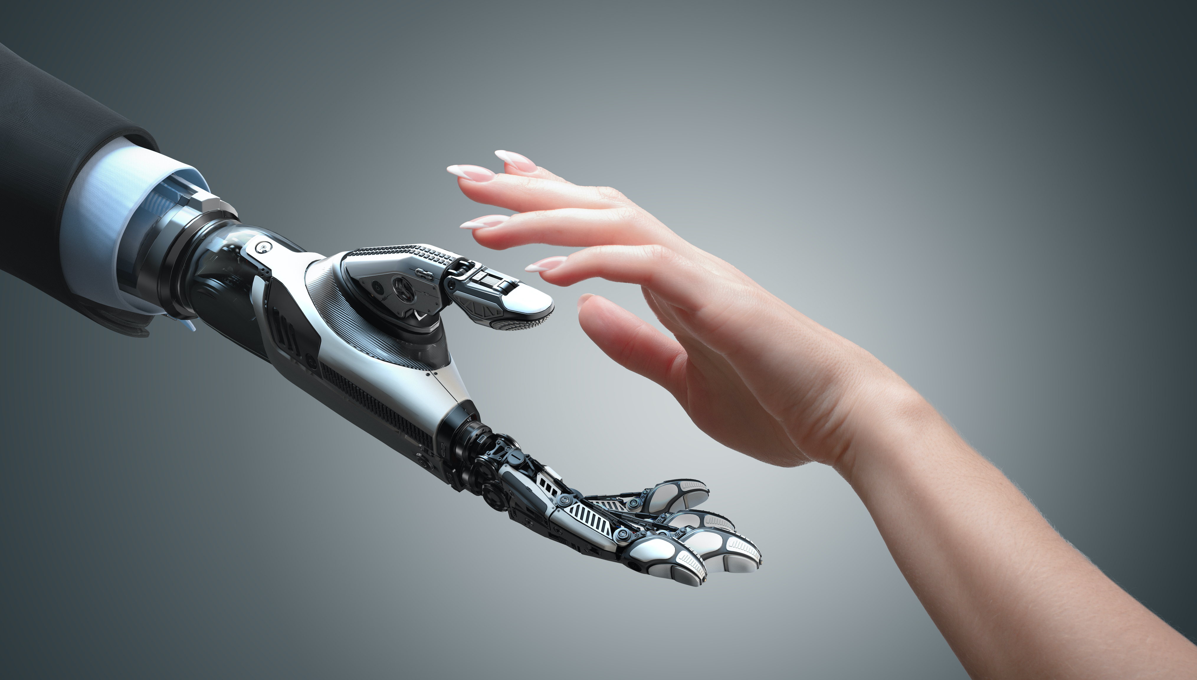 A robot arm wearing a suit reaching out to offer a helping hand to a human hand