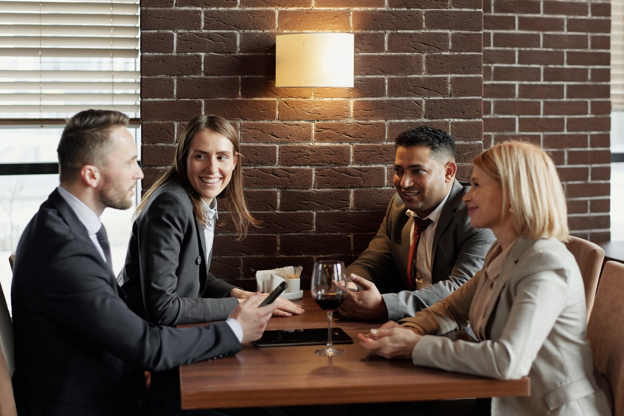 business team members sitting at restaurant