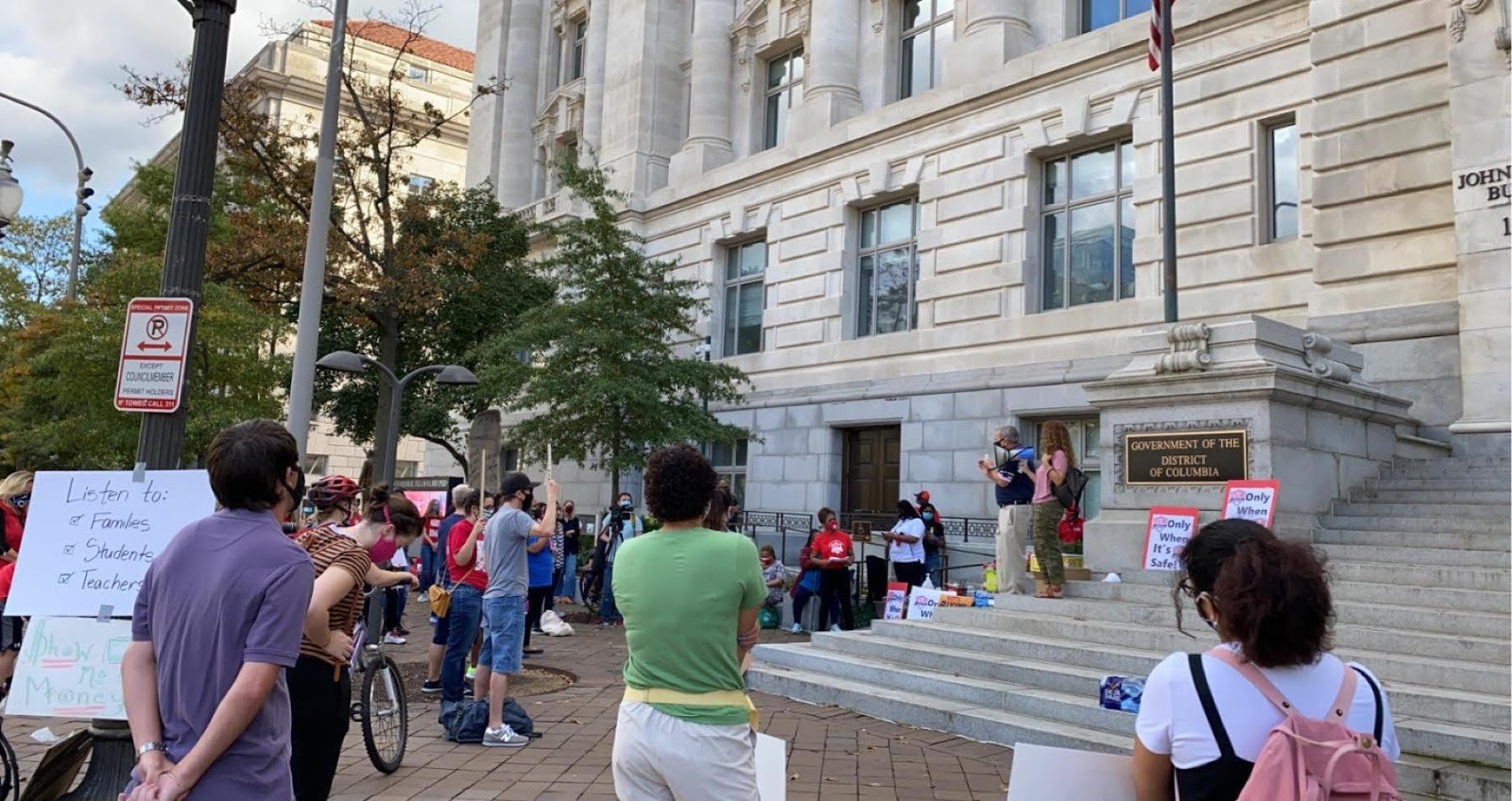 WTU rally with teacher and parent testimony outside Wilson Building. Photo by Dylan Craig
