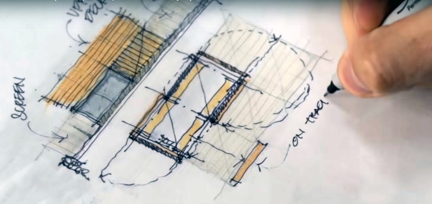 Man drawing a plan of a future custom home