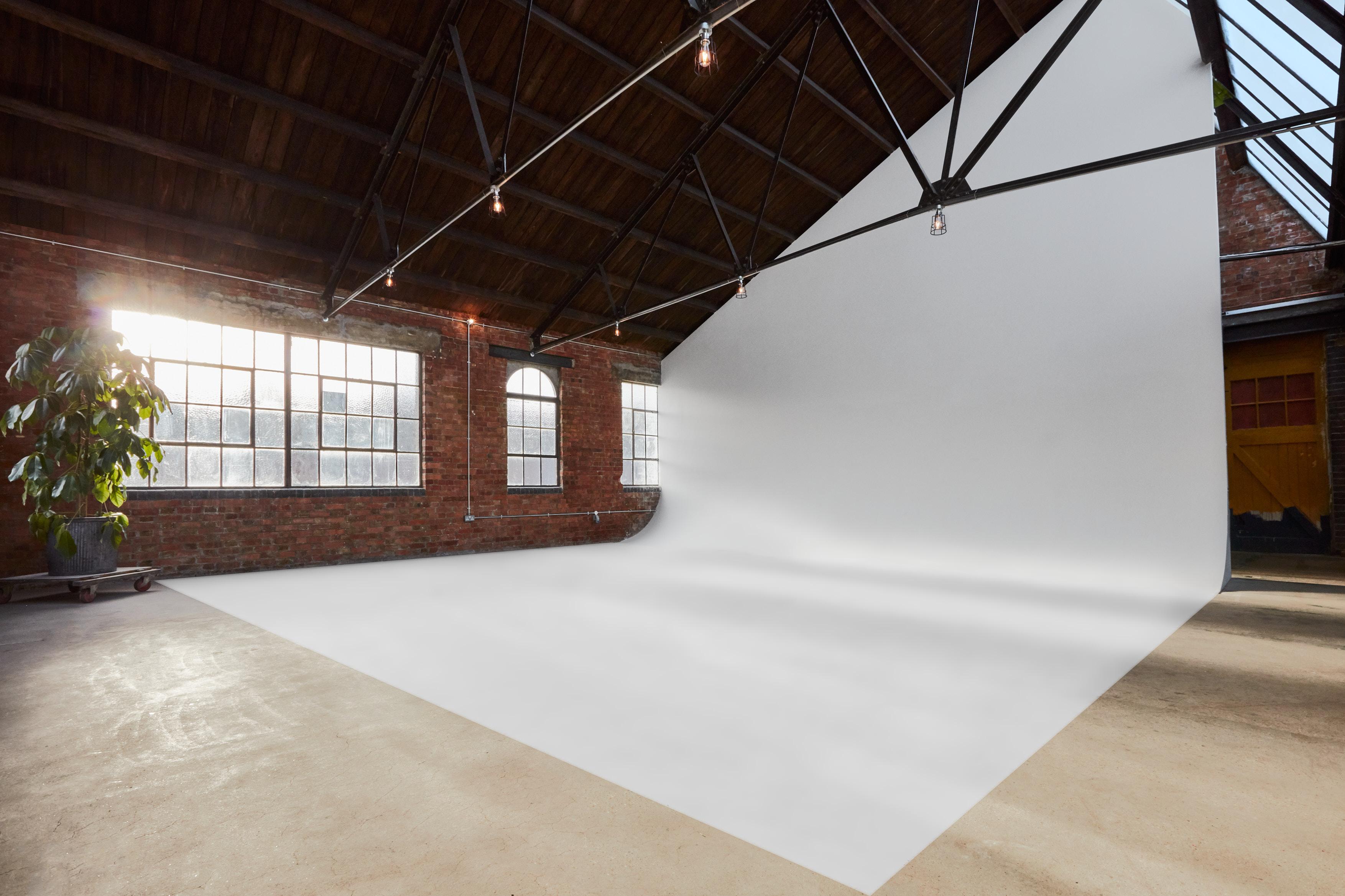 creative photo studio with angled curved wall