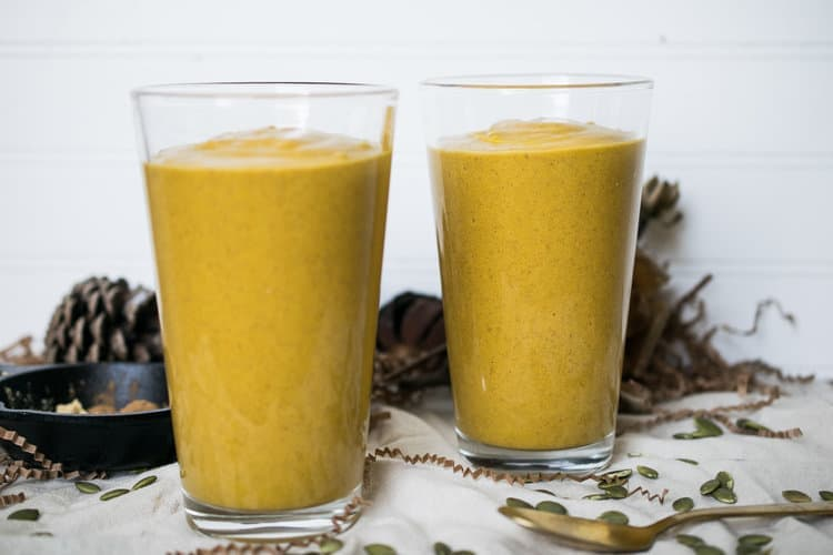 Two glasses filled with pumpkin spice collagen smoothies