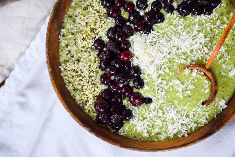 Matcha protein smoothie bowl with hemp hearts blueberries and coconut