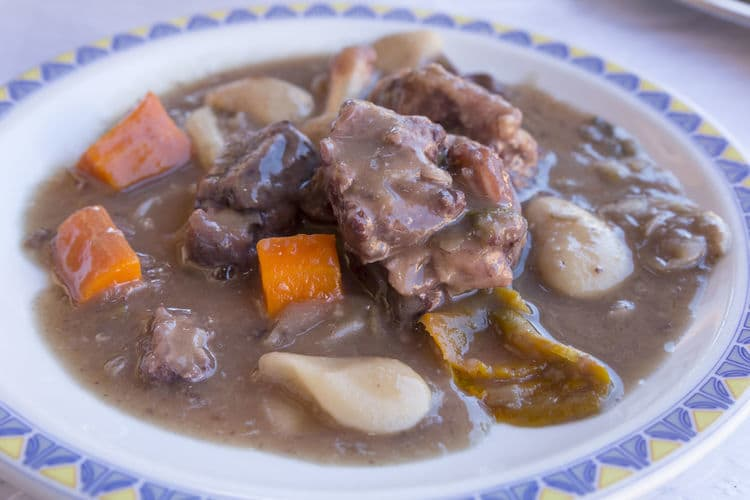 Bowl of nutritious beef stew with potatoes and carrot