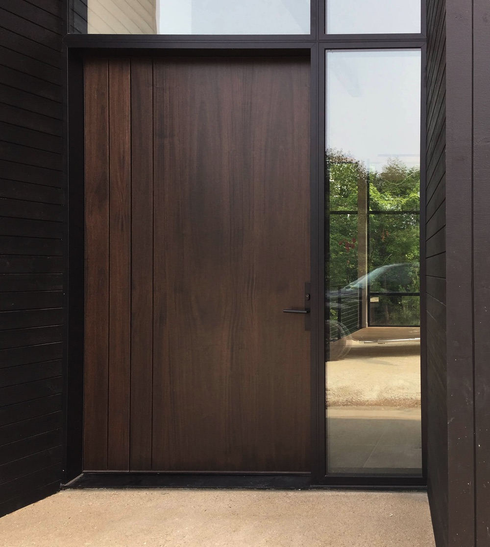 Pivot 8 foot door with vertical shadow grooves and clear sidelite and transom closeup image