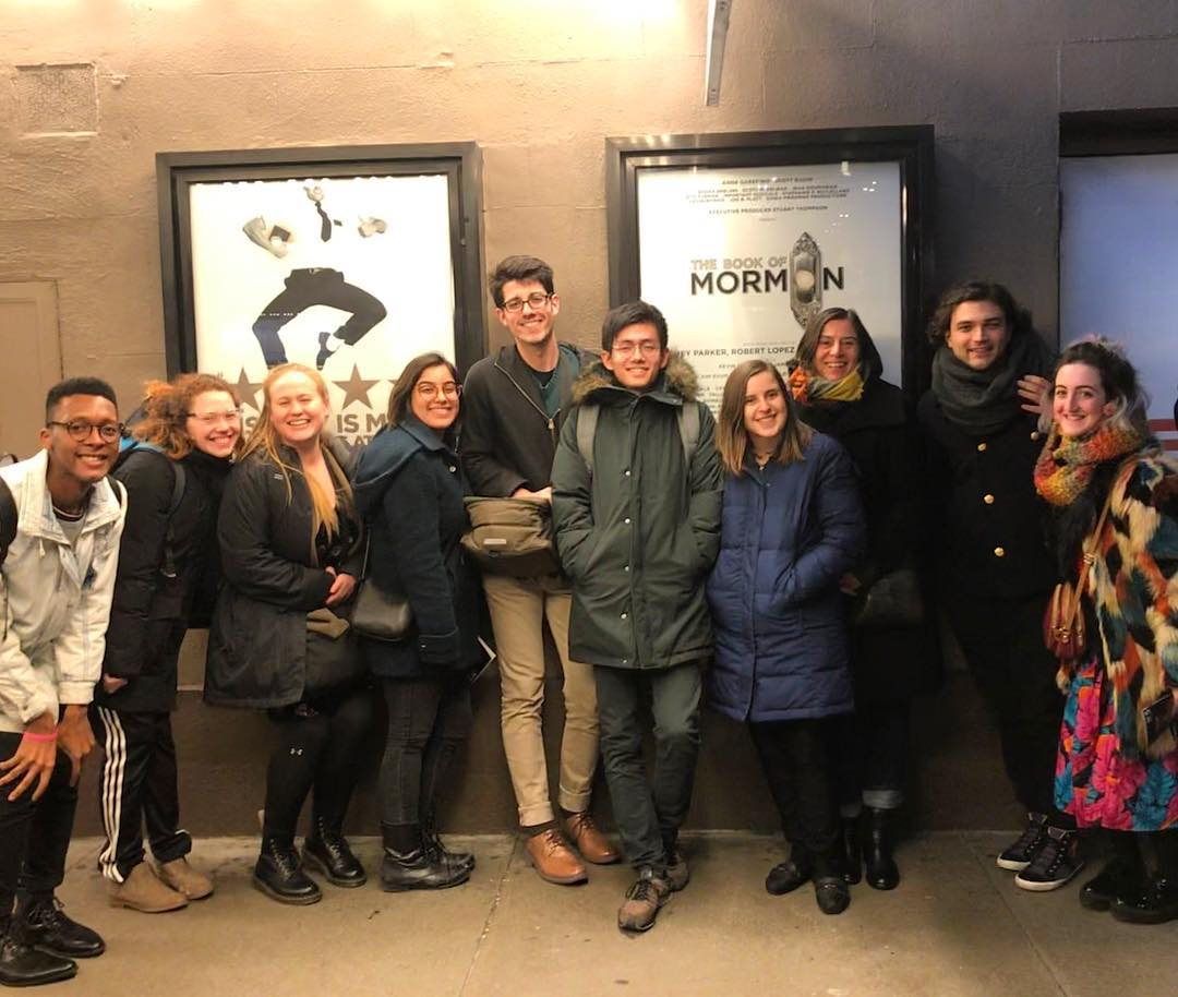 Trinity La MaMa students posing in a group outside a Broadway show