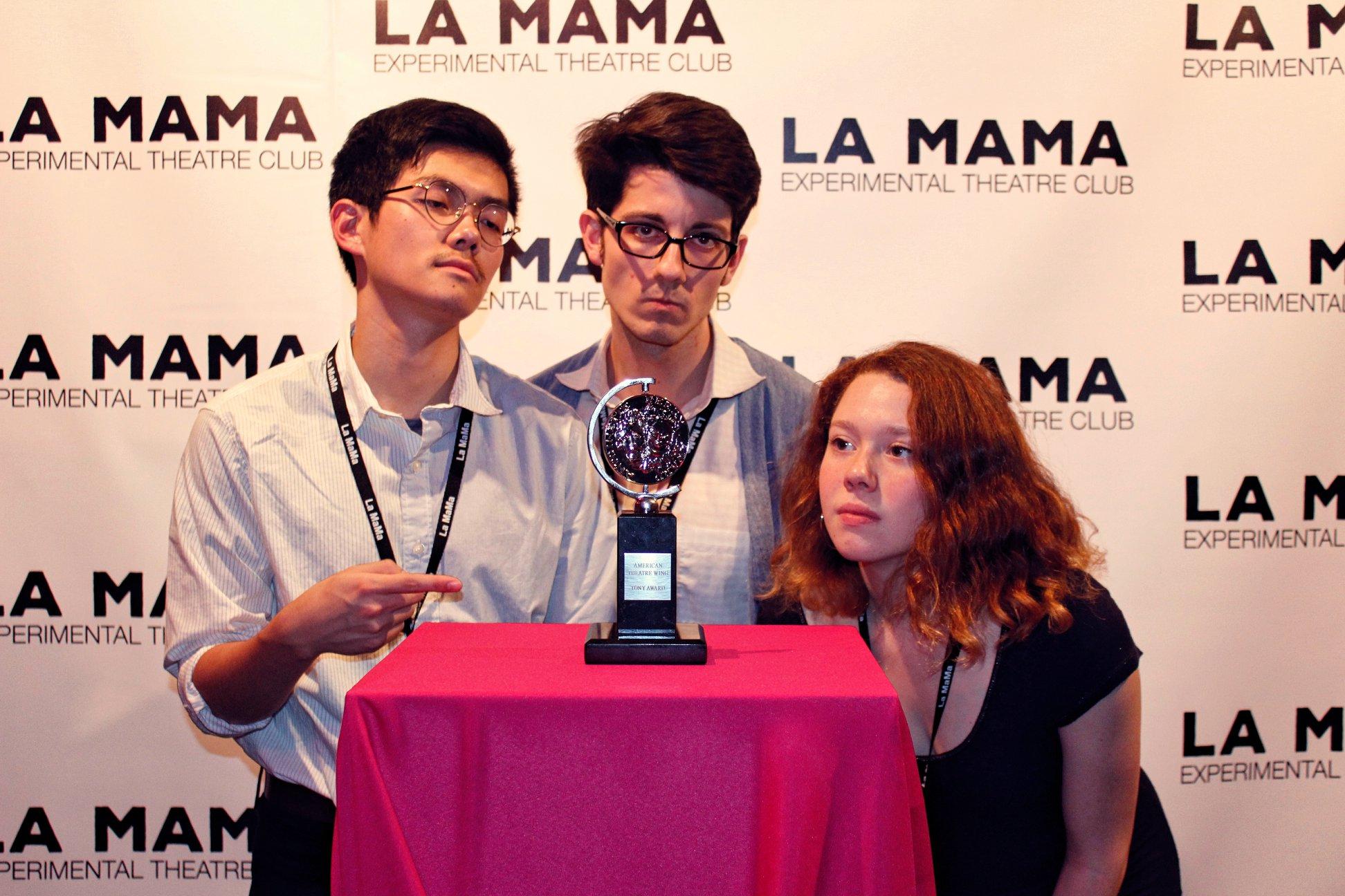 Trinity La MaMa students posing in a group with a Tony Award