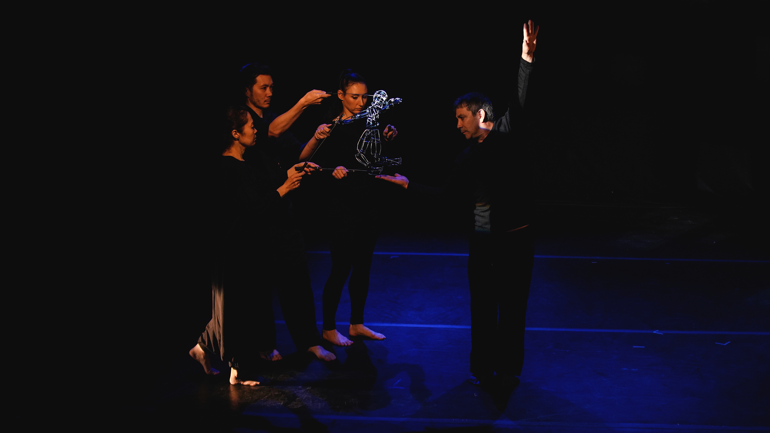 Photo of puppeteers performing on stage from Loco7 Dance Puppet Theatre