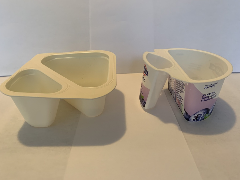 Two empty flip yogurt containers