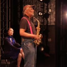 man holding a saxophone