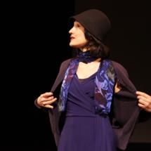 woman wearing black cardigan and black hat