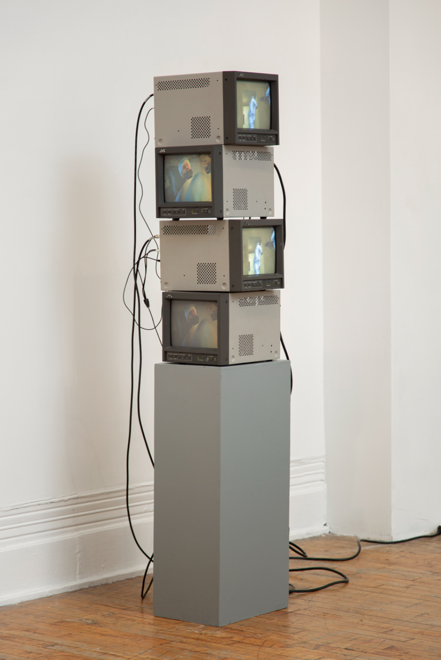stack of four tv sets