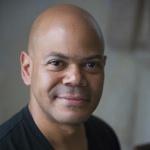 Headshot of Charles Rice-González