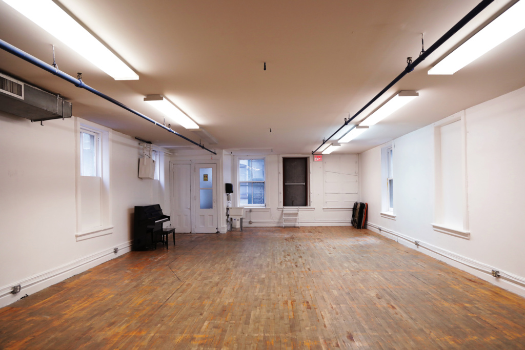 A wide shot of La Mama's rehearsal studio on the fourth floor at 47 Great Jones St.