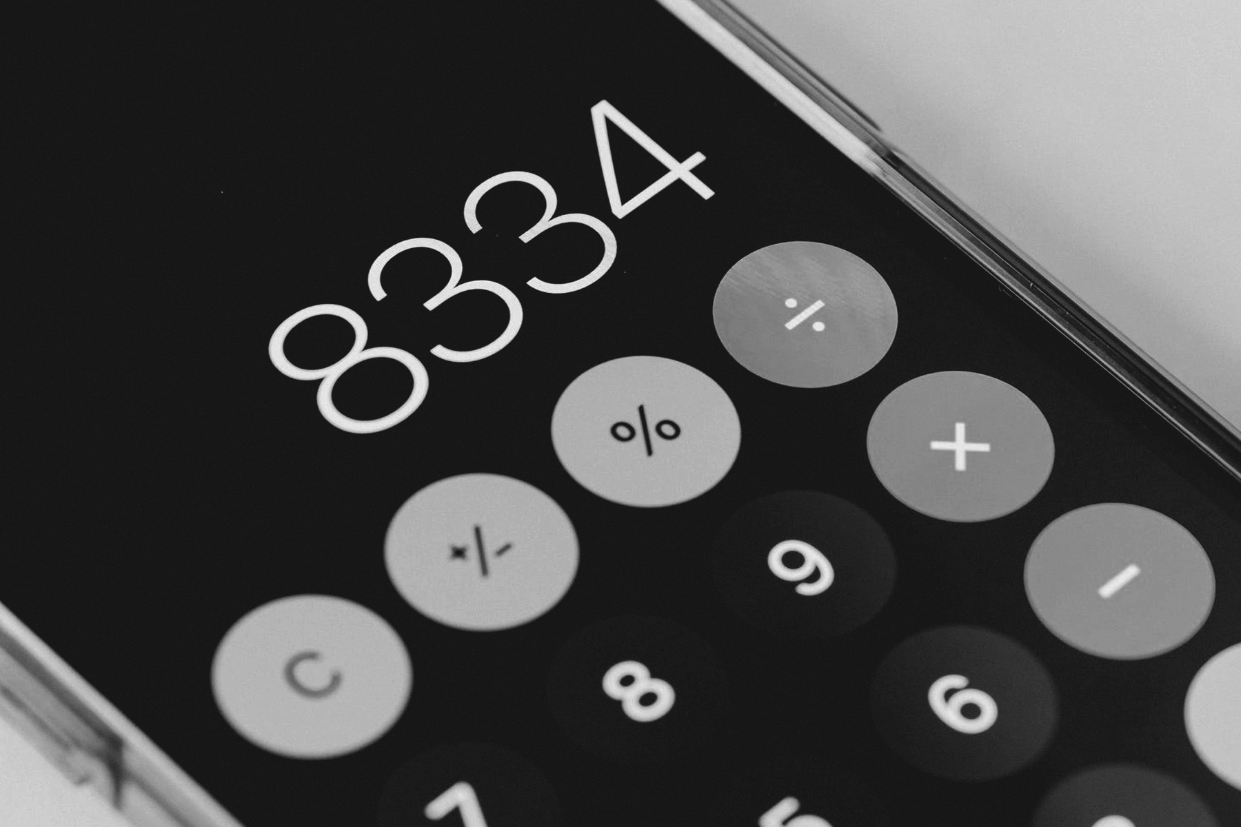 an iphone displaying a calculator app with the number 8334 displayed.