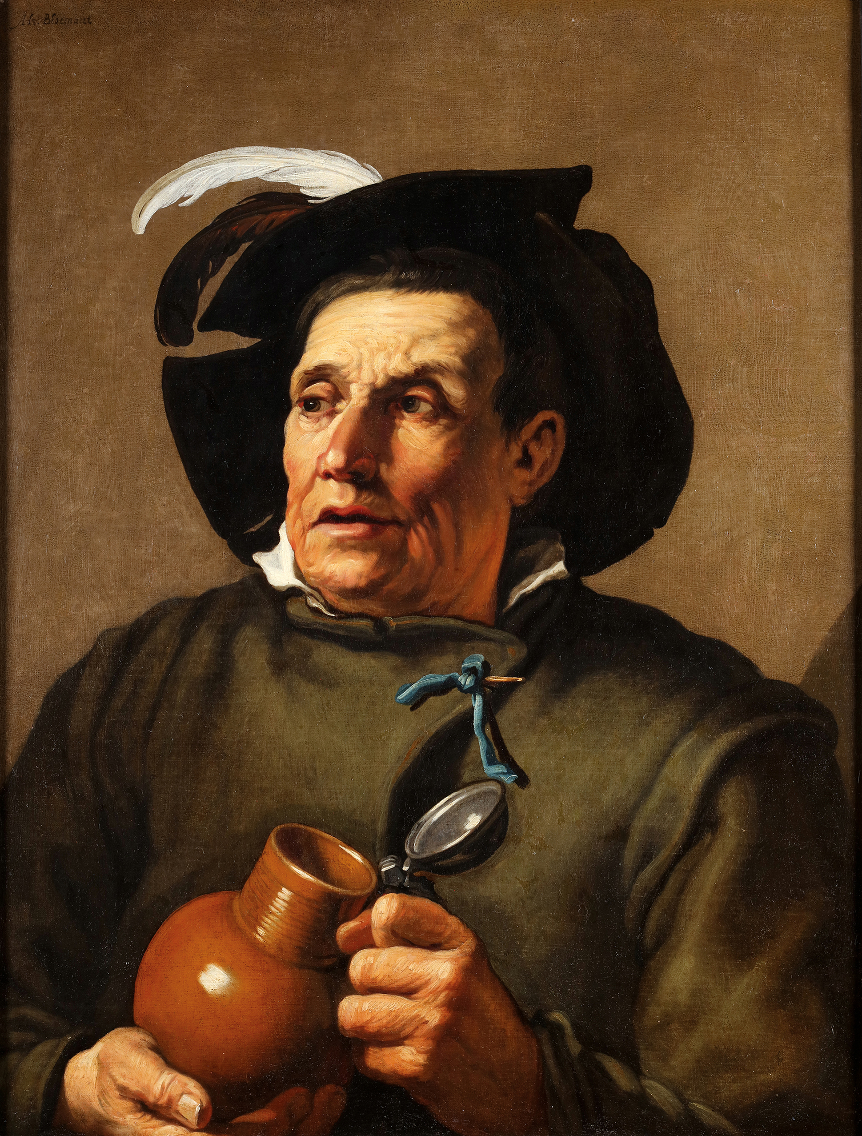 Portrait of a man holding a jug