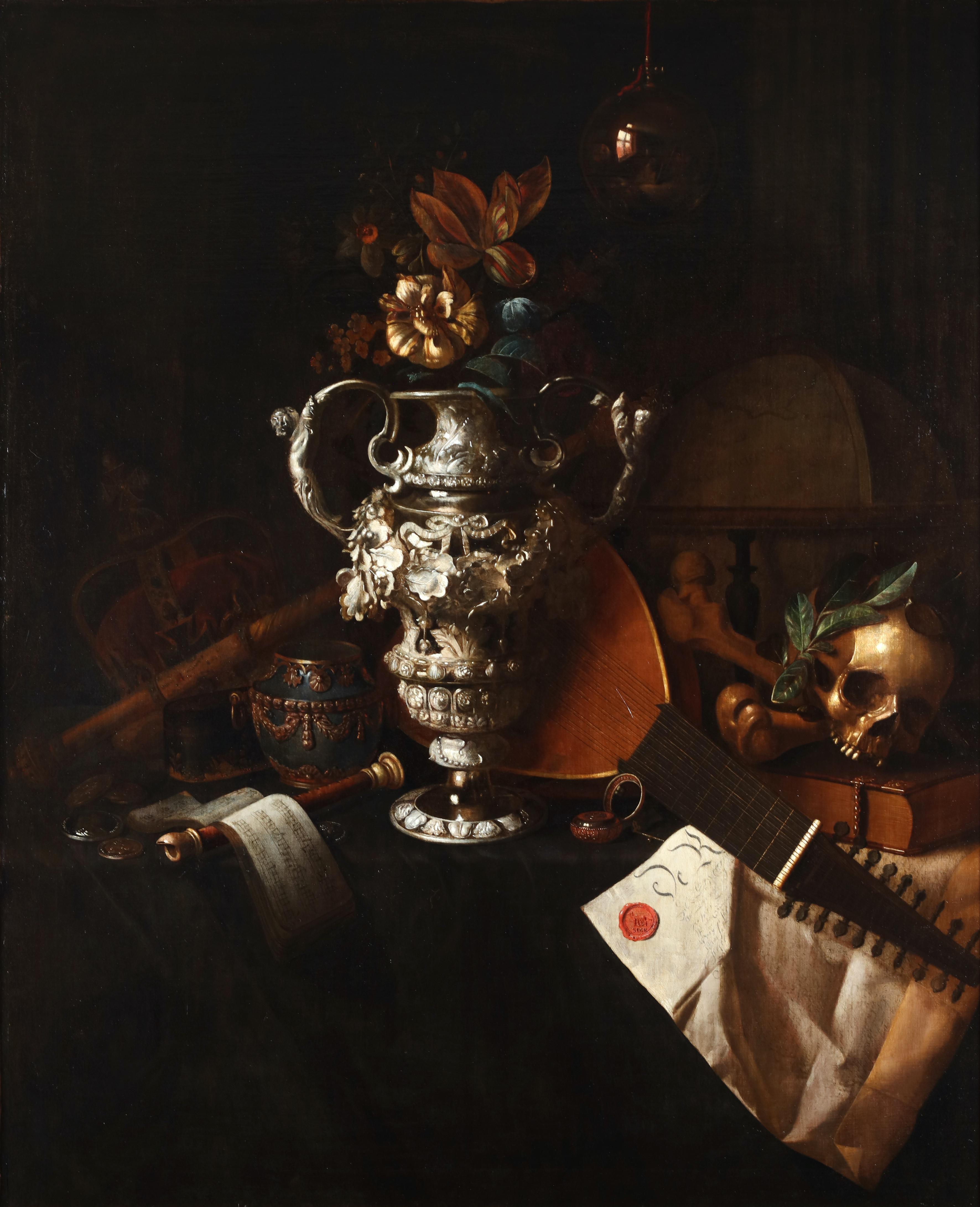 A vanitas still life with an elaborate silver vase