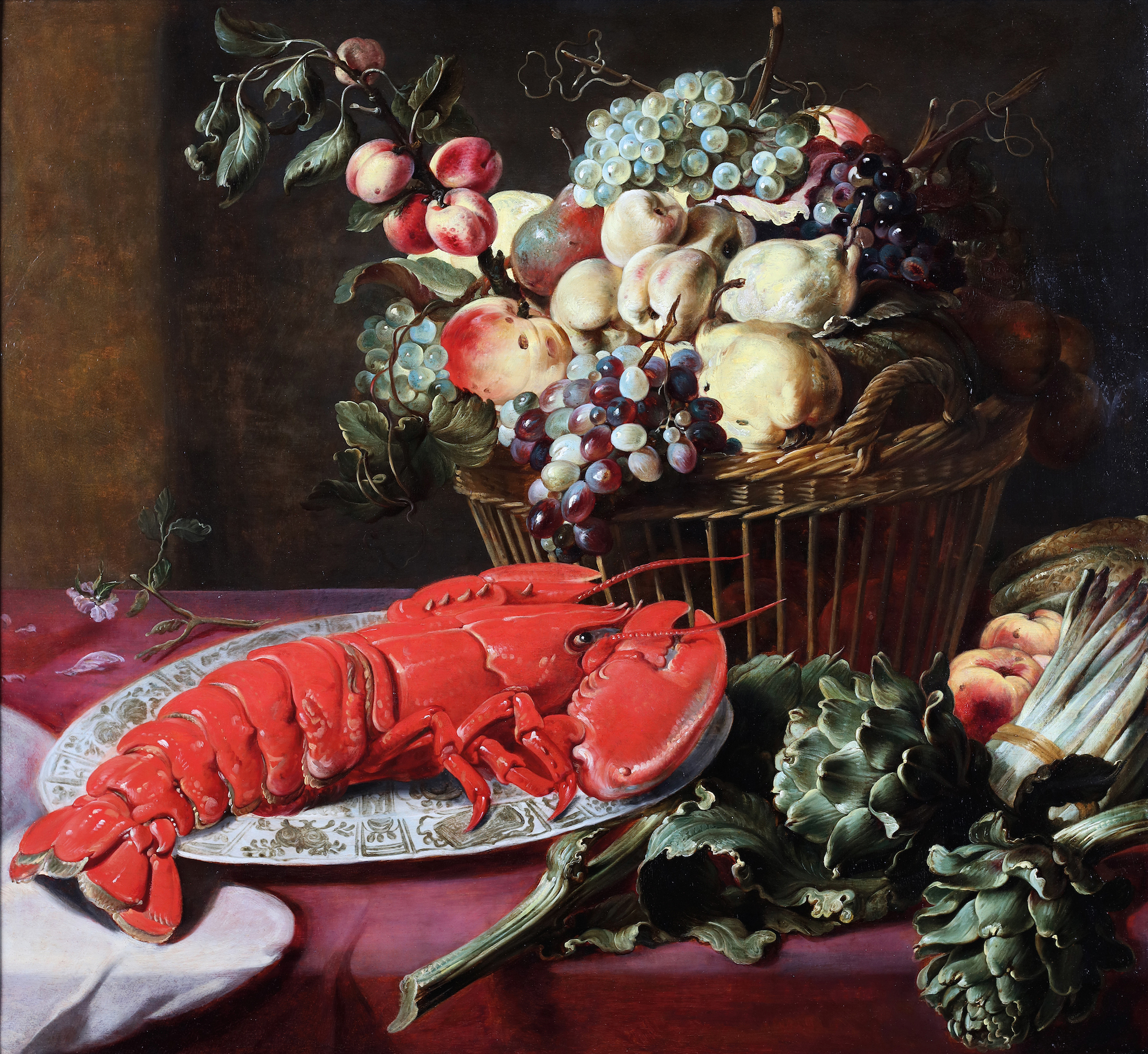 Still life with a lobster, fruits, artichokes and asparagus on a table