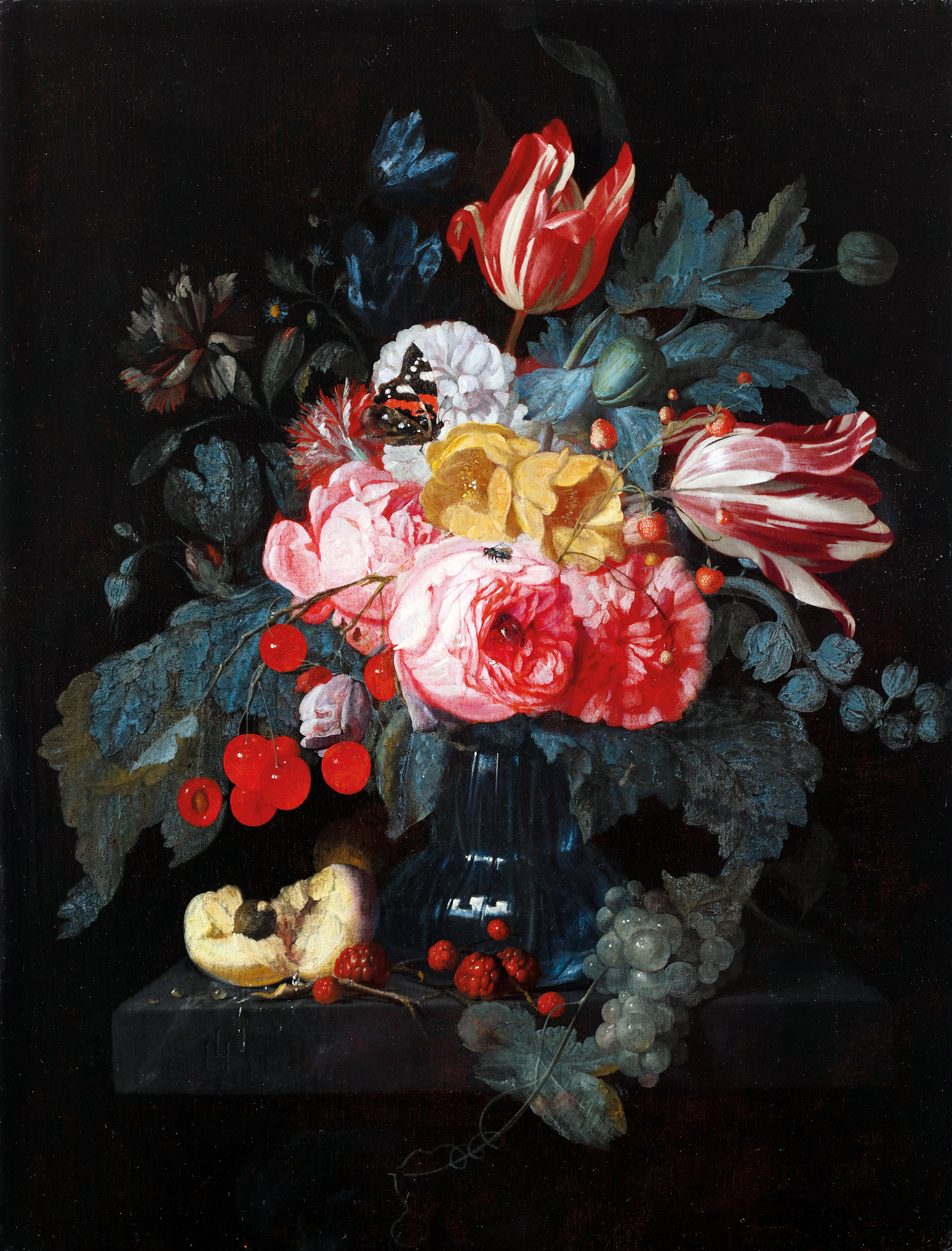 Flowers and fruits in a vase on a table ledge