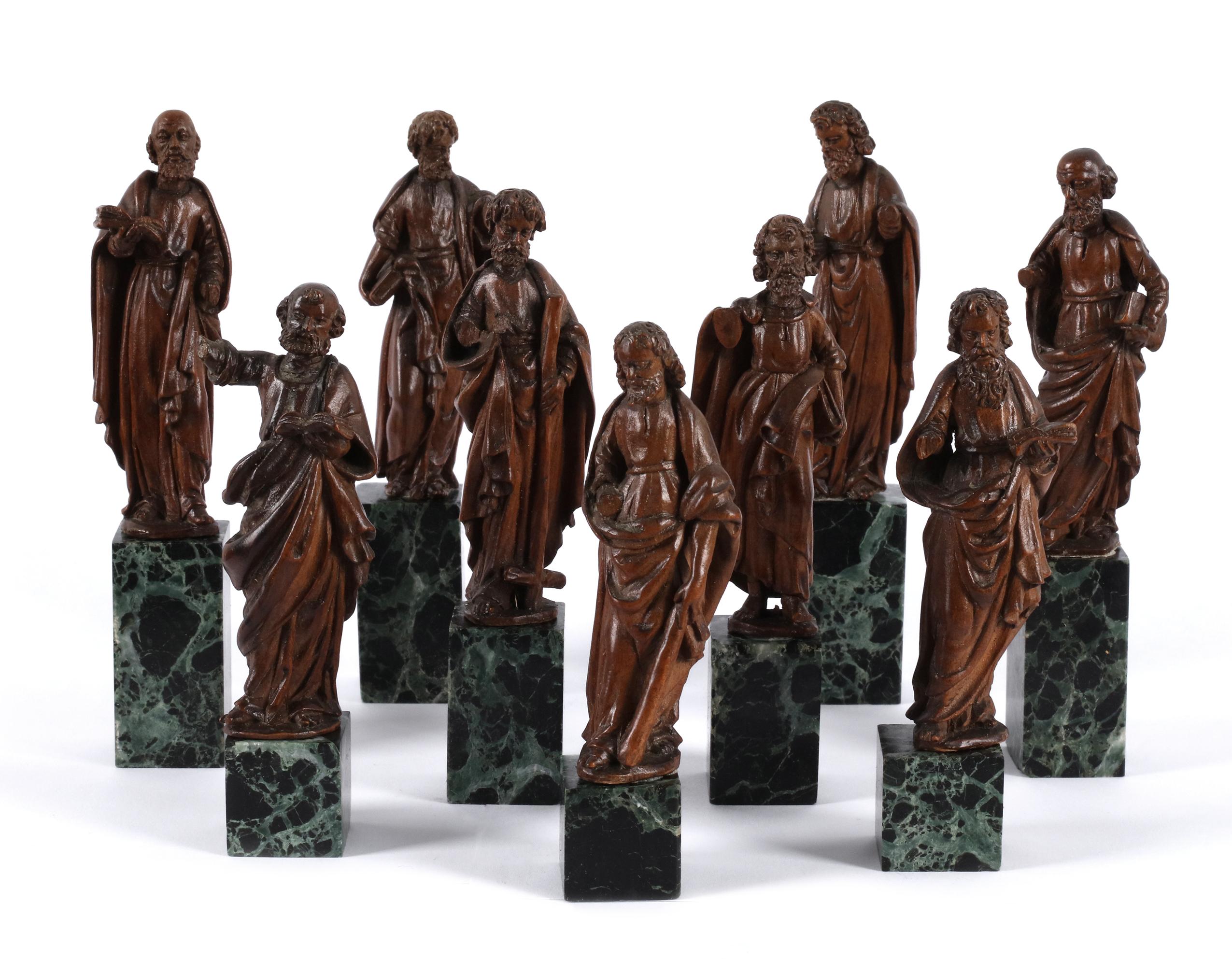 A serie of 9 apostle-sculptures