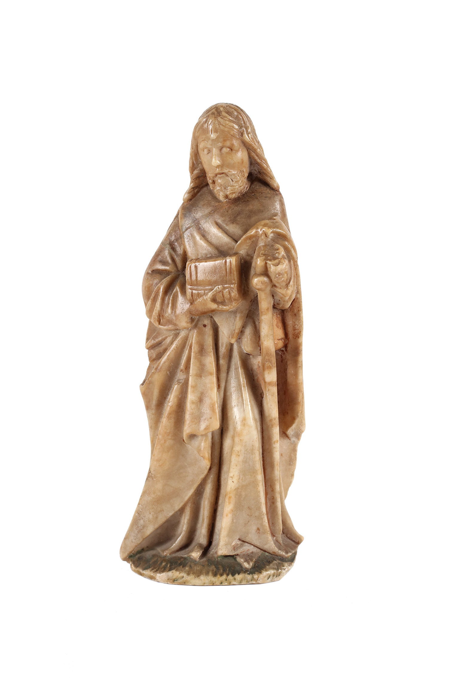An alabaster figure of an apostle with a book and pilgrim's stick.