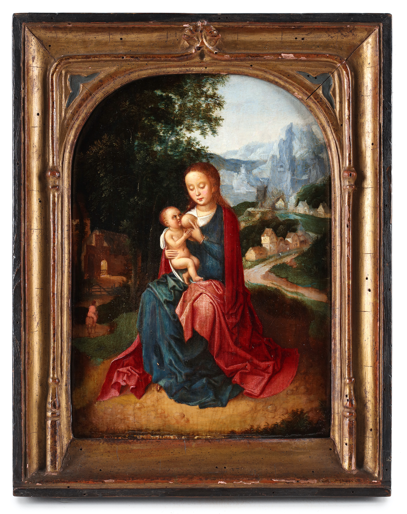 A seated Virgin with child in a mountainous landscape