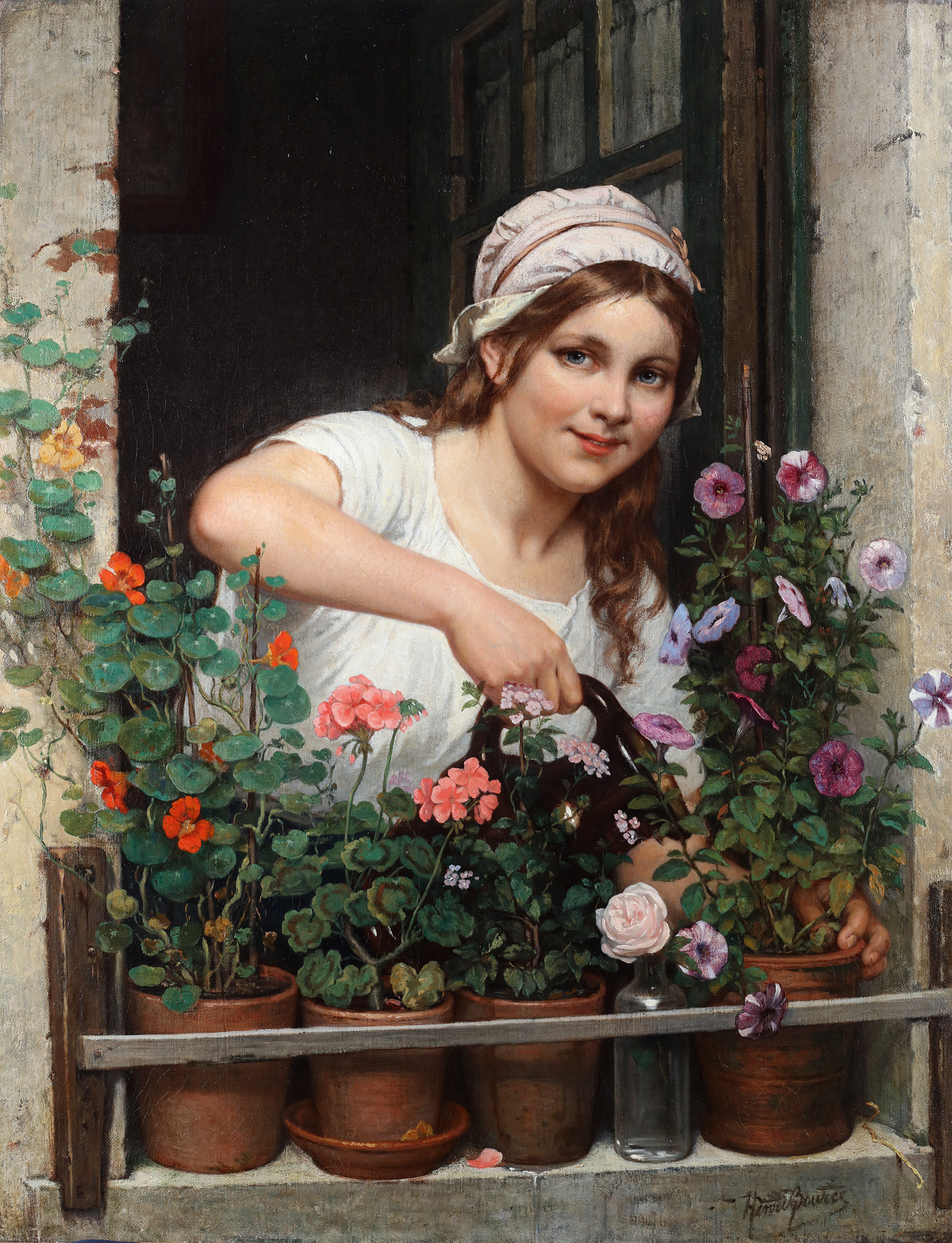 Young girl watering her flowers
