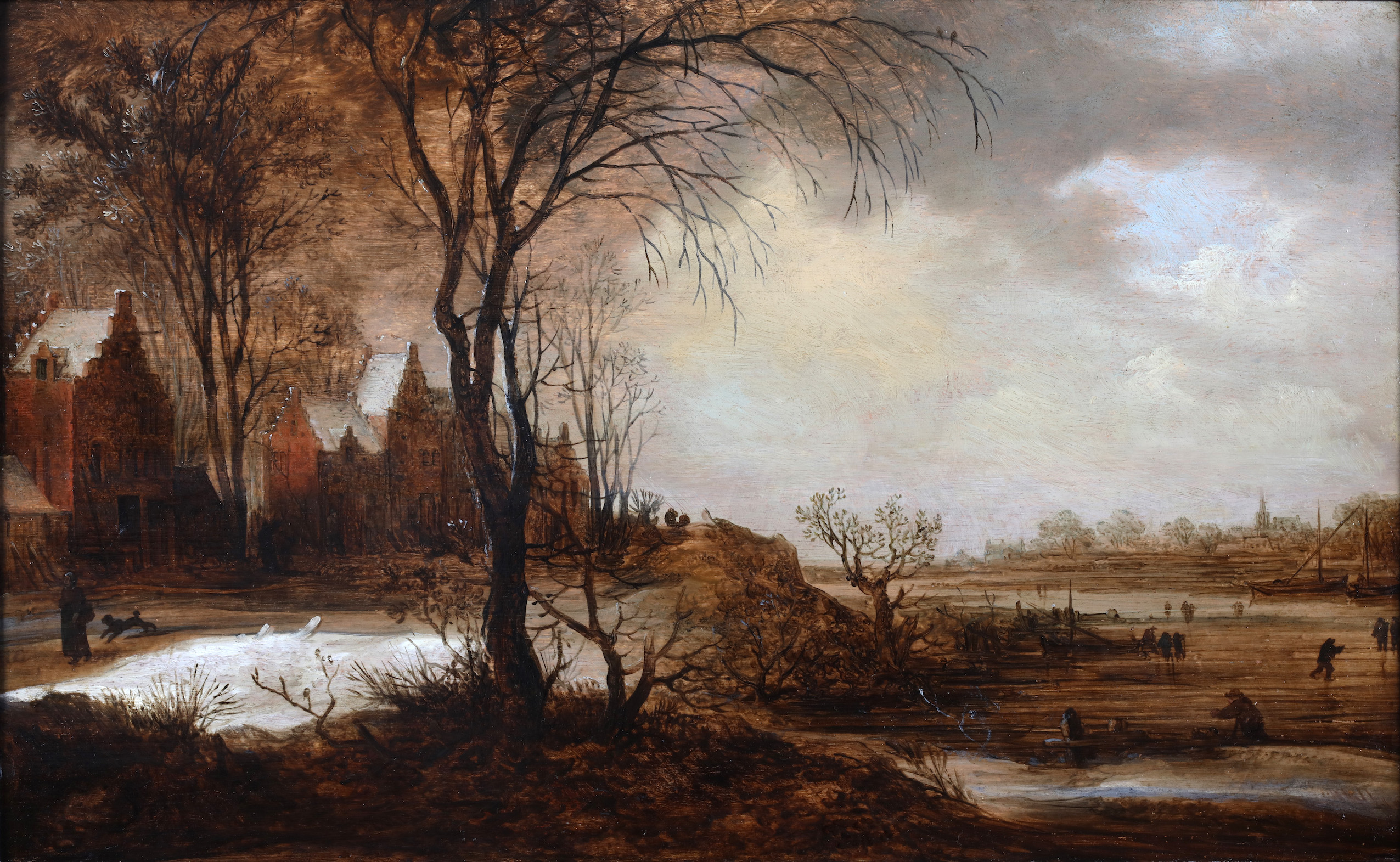 A winter landscape with skaters on the ice