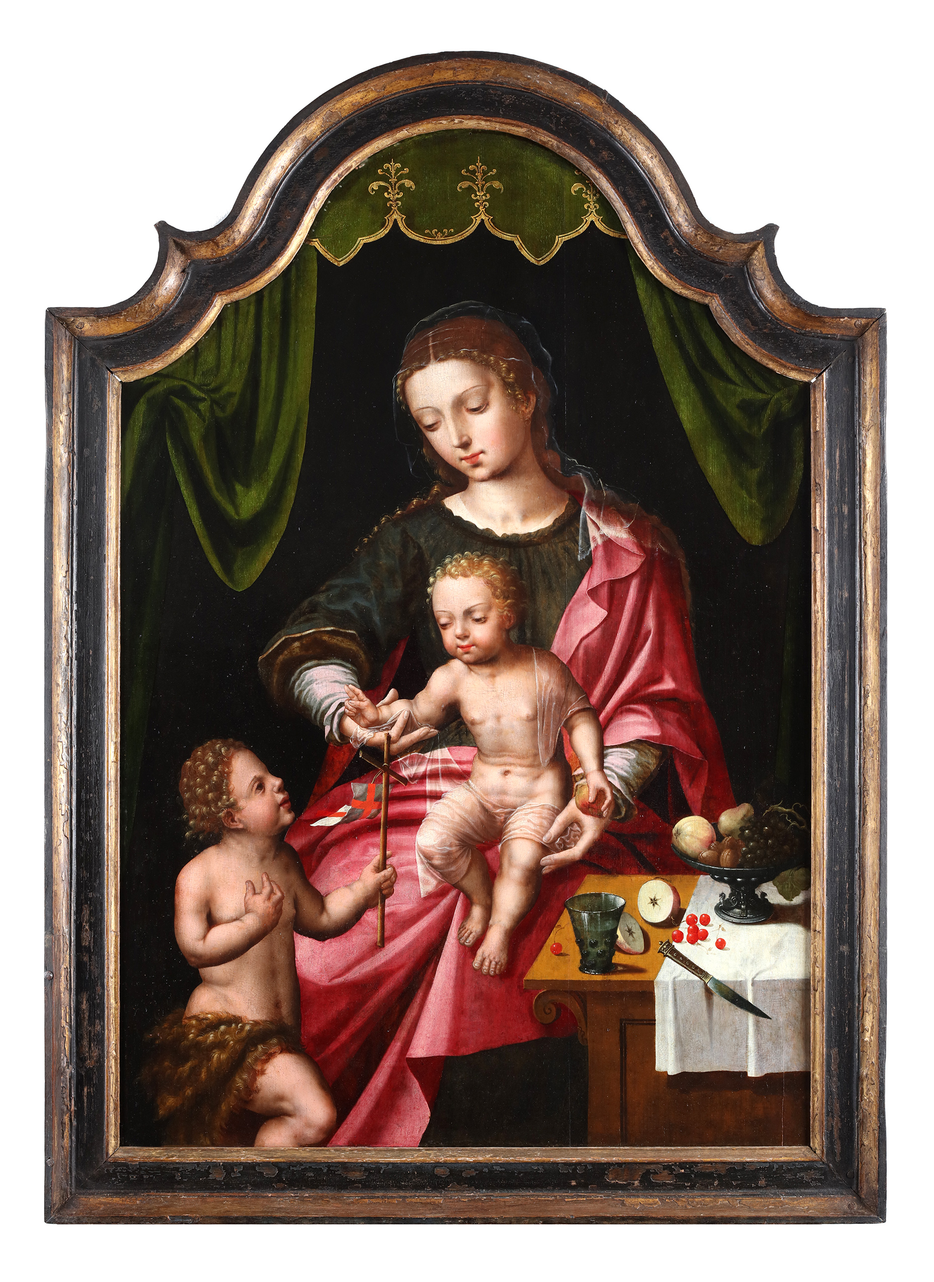 A seated Virgin and Child, with Saint John Baptist kneeling on the left, a still life of fruits on a buffet on the right
