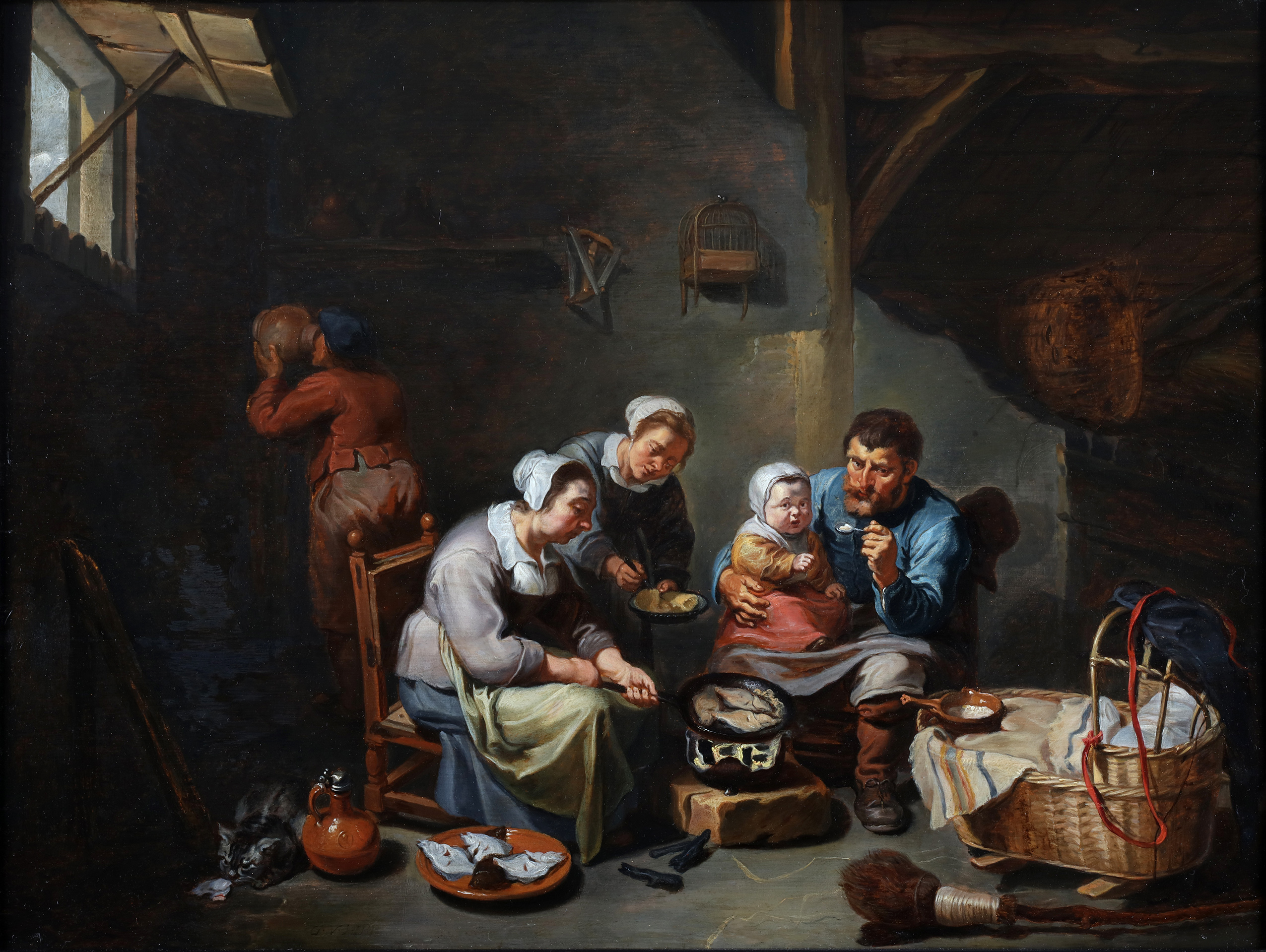 Interior with a peasant family frying fish