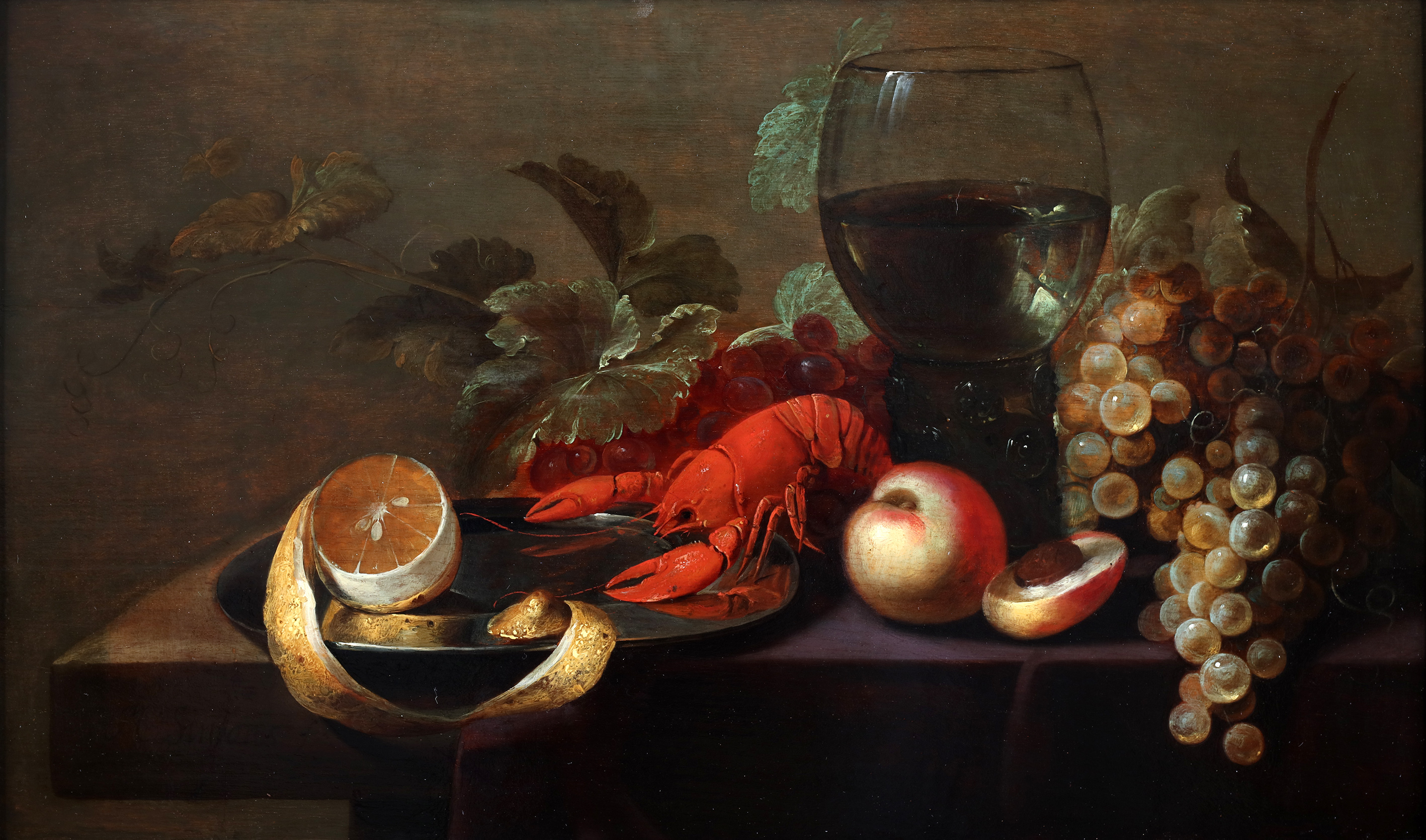 Still life with a lobster, a roomer, fruits and a peeled lemon on a tin plate