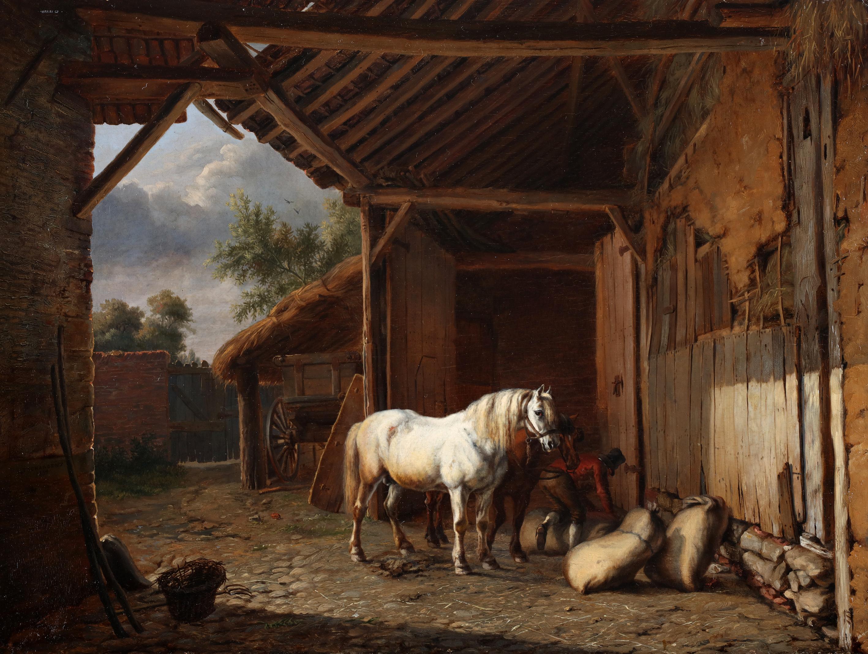 Horses on the inner court of a barn