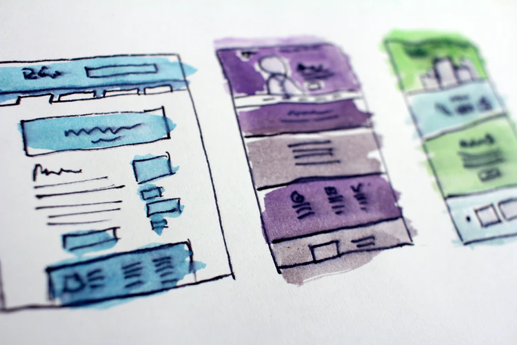 Outline of 2 website pages with blue, purple, and green watercolor filled into each